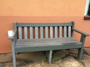 bench with tea cup